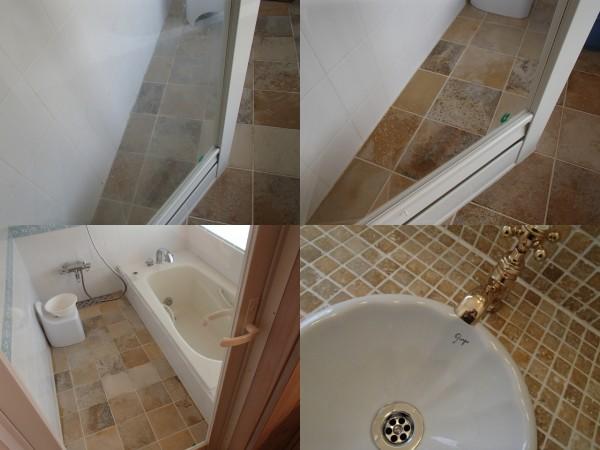 浴室のガラス扉を磨く